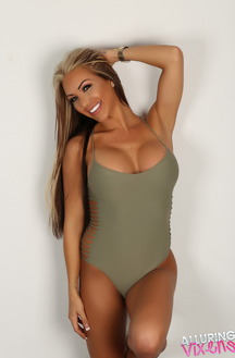 Busty Blonde Kimmy Teases In Skimpy Bodysuit