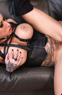 Tattooed Whore Fucks On The Couch