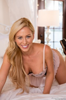 Cherie Deville On A Bed Shows A Good Striptease