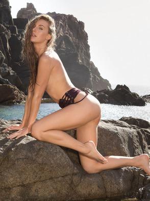 Superwoman Jennifer Love Strips Outdoors