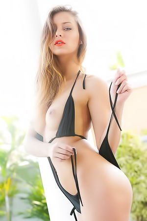 Beautiful Stunner Yaryna Lounges Around The Pool