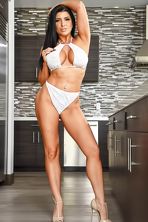 Romi Rain Loves Showing Her Boobs In The Kitchen