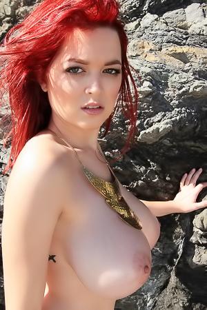 Ginger cutie on a beach.
